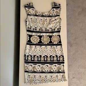 Dresses & Skirts - Black, gold and white body con dress